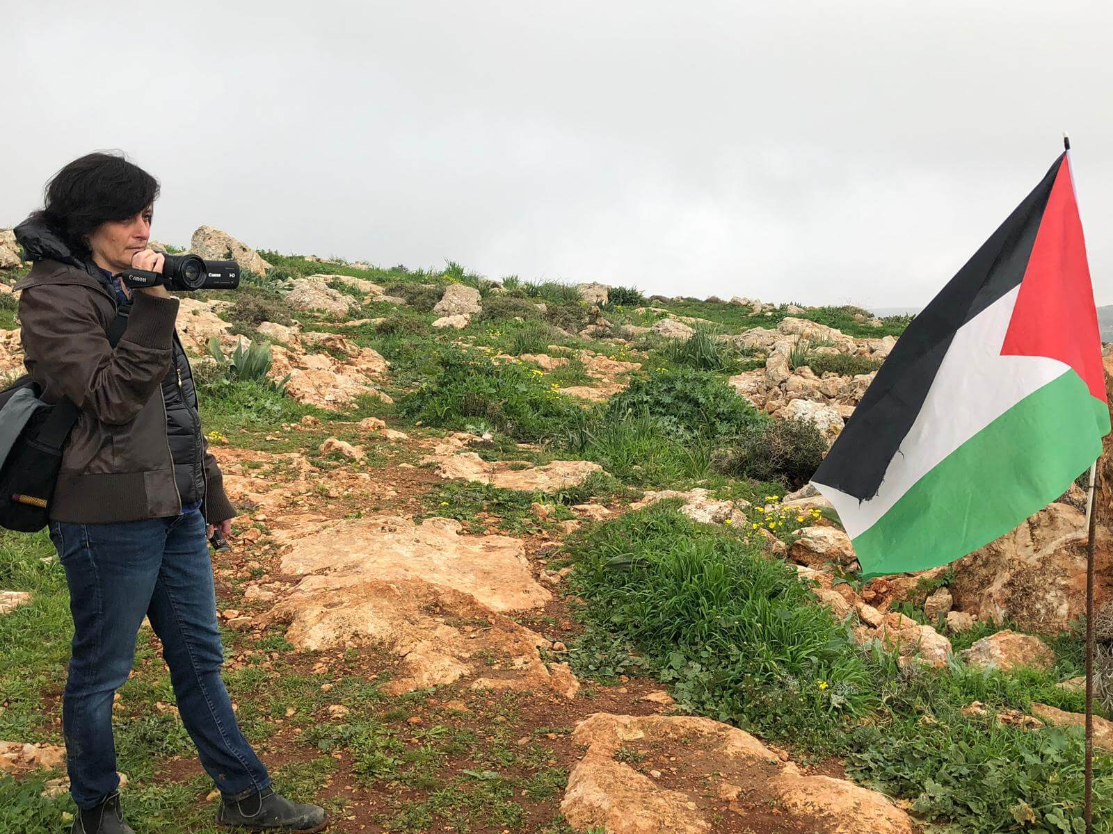 Jen Marlowe filming the site where Hamdi Na'aman had been shot and killed by settlers in Mughayyir.