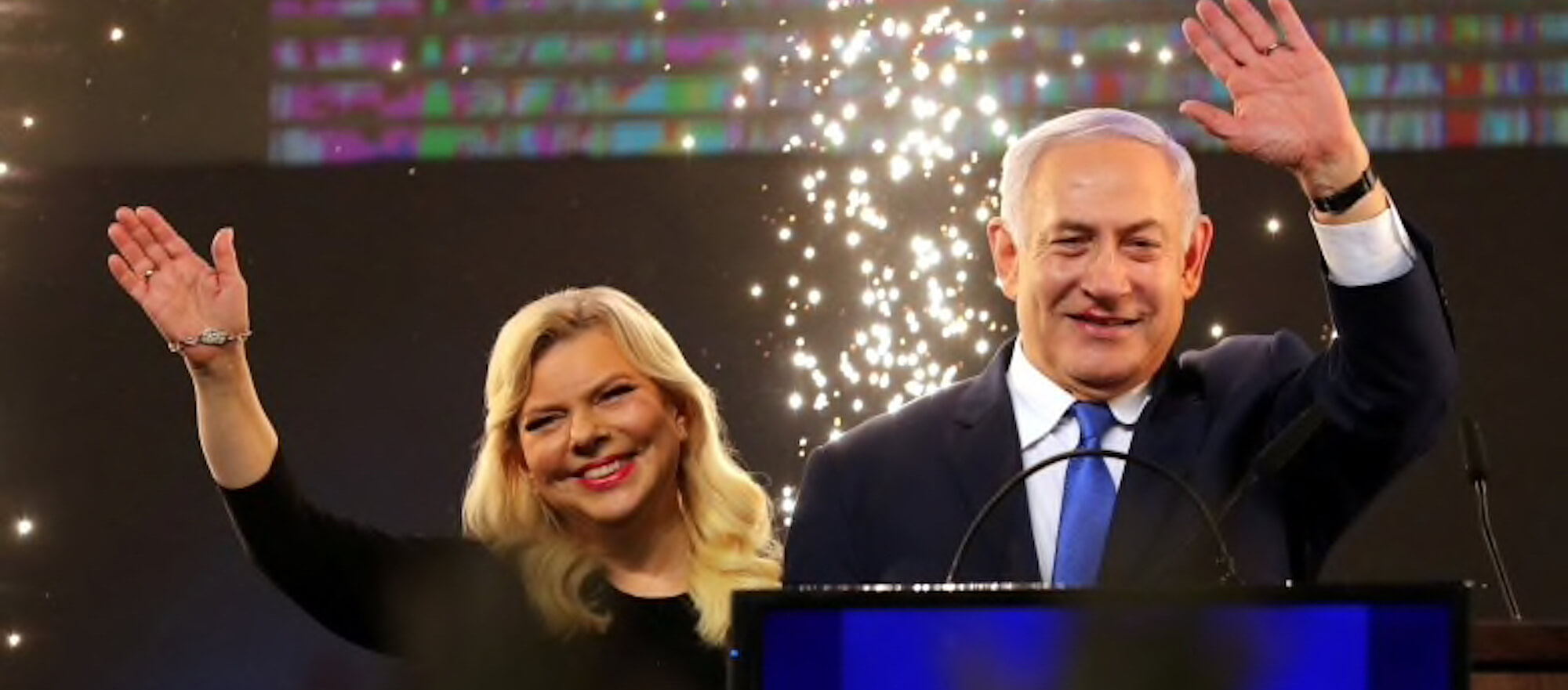 Benjamin Netanyahu and his wife Sara wave as Netanyahu speaks following the announcement of exit polls in Israel's parliamentary election at the party headquarters in Tel Aviv. (Photo: Ammar Awad/Reuters)