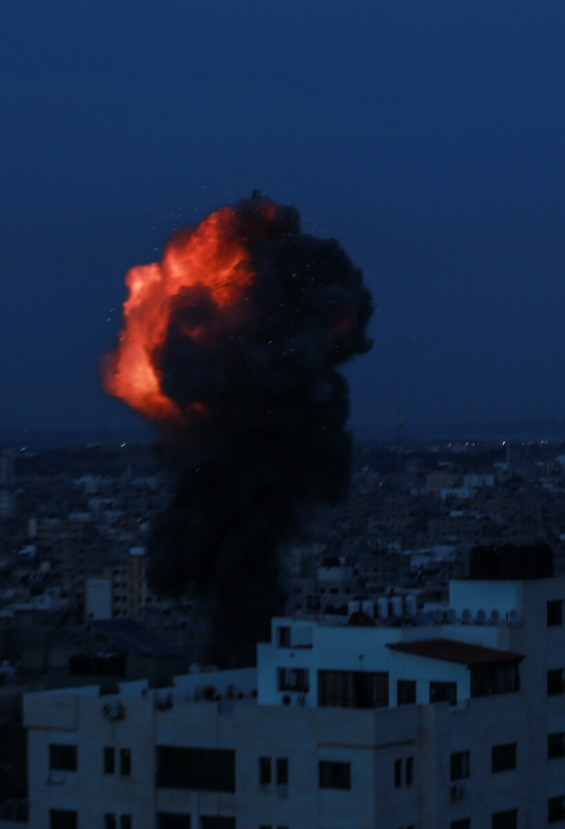 A ball of fire and smoke is seen following an Israeli airstrike that hit al-Yarmouk football stadium in Gaza city on May 5, 2019.