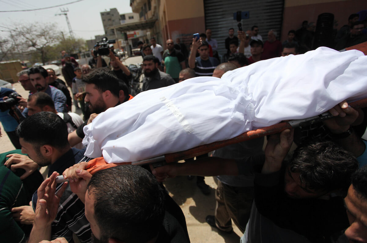 Mourners carry the body of Palestinian Iman Usraf during her funeral in Gaza City on May 6, 2019. (Photo: Mahmoud Ajjour/APA Images)