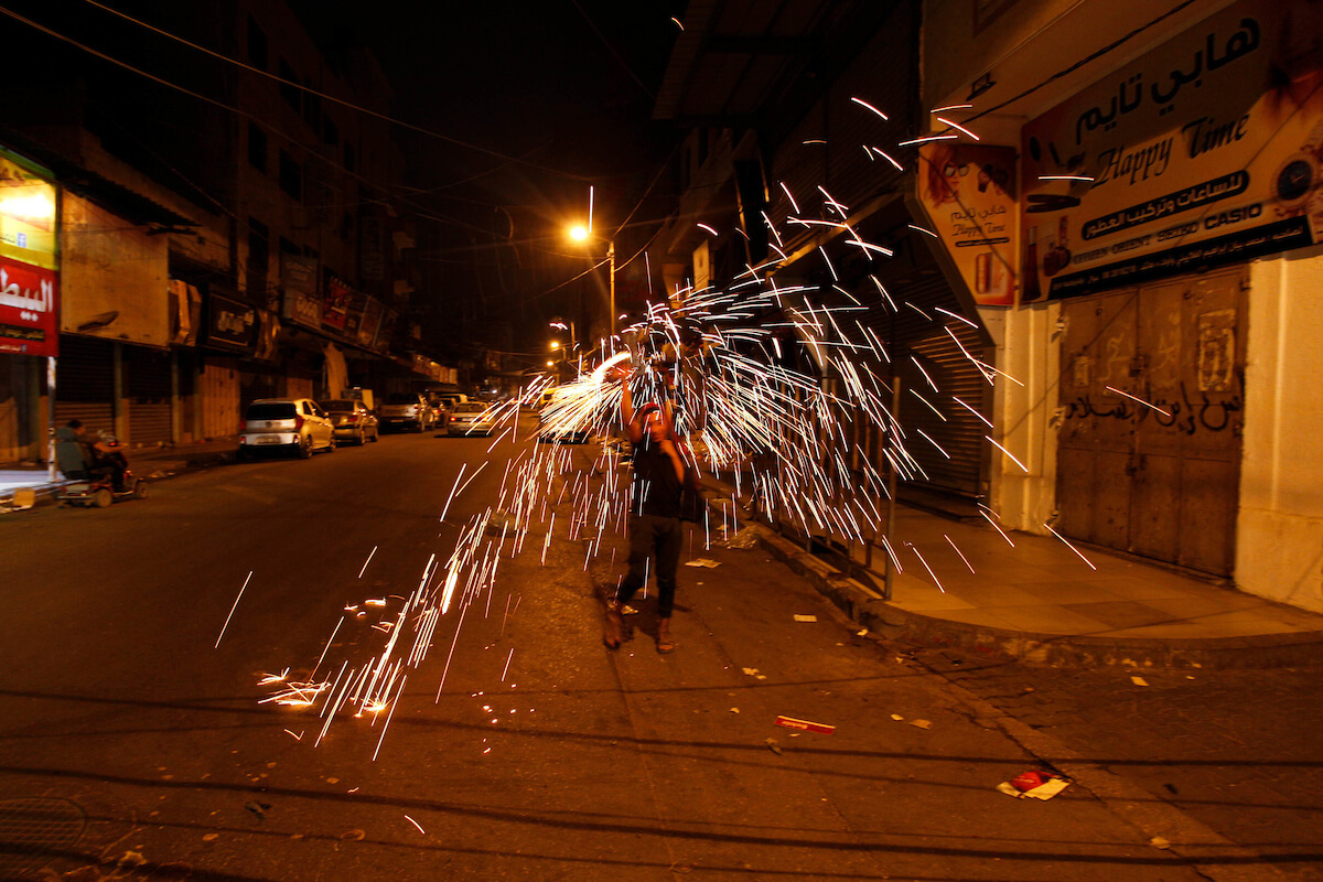 Palestinian children play with fireworks after breaking the fast during the first day of Muslims holy month of Ramadan, in Gaza city on May 6, 2019. Muslims around the world celebrate the holy month of Ramadan by praying during the night time and abstaining from eating, drinking, and sexual acts during the period between sunrise and sunset. Photo by Mahmoud Ajjour