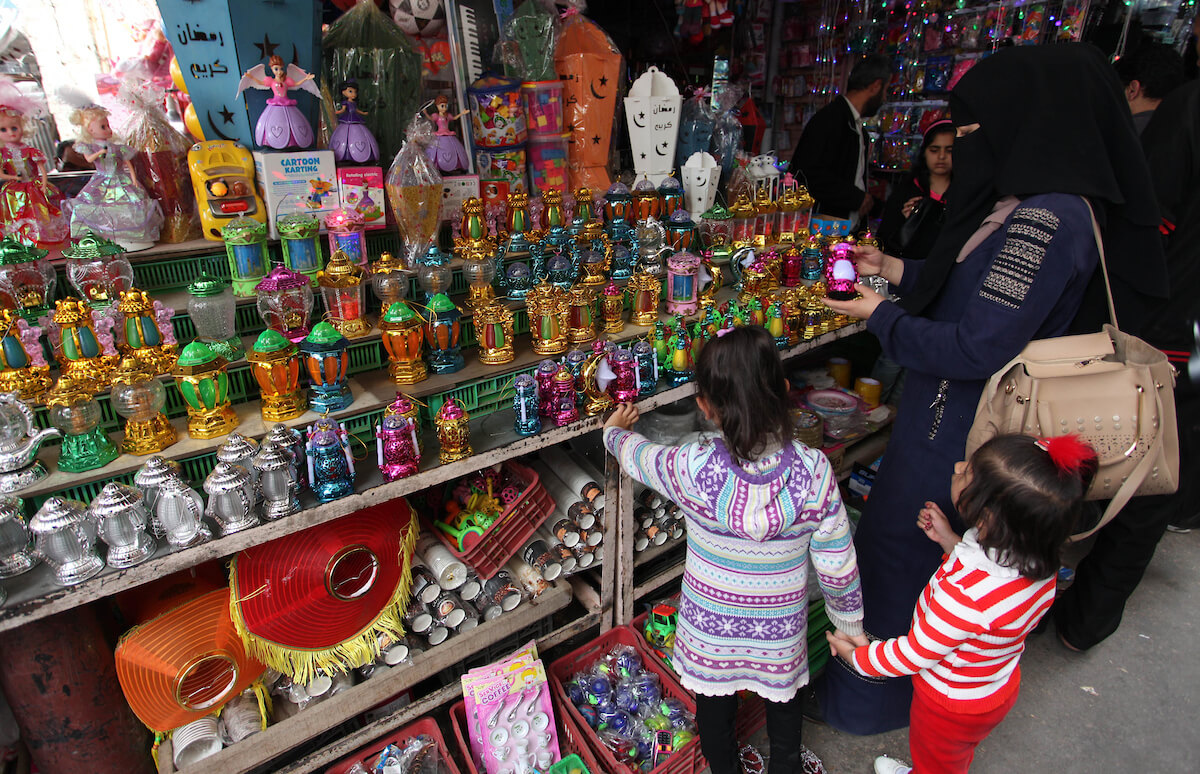 Palestinians shop for sweets at al-Zawya market during the holy month of Ramadan, in Gaza City on May 6, 2019. (Photo: Mahmoud Ajjour/APA Images)