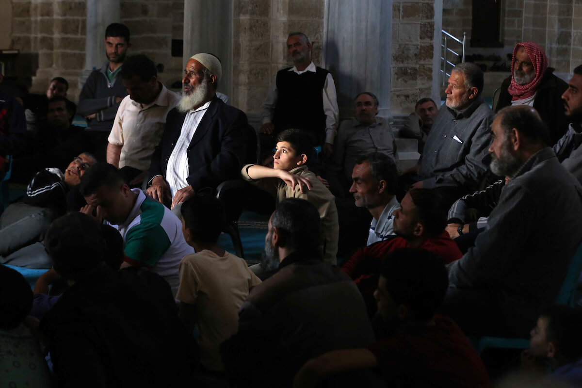 Palestinians pray at al-Omari mosque, during the Islamic holy month of Ramadan, in Gaza city on 07 May 2019. Muslims around the world celebrate the holy month of Ramadan by praying during the night time and abstaining from eating, drinking, and sexual acts during the period between sunrise and sunset. Photo by Ashraf Amra