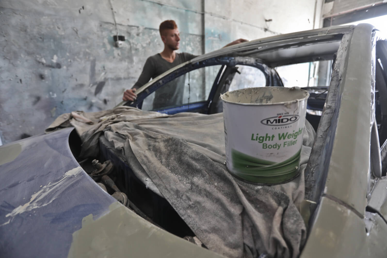 Painting cars in Gaza