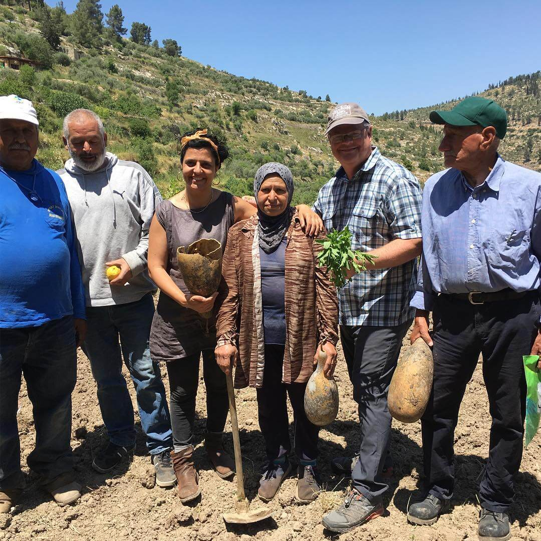 Members of the Palestine Heirloom Seed Library hold yakteen, or green gourds, in front of the terraced slopes of Battir in the West Bank. The Palestinian Heirloom Seed library is project to salvage and propagate Palestinian agri-cultural heritage through story, seed, and art. (Photo: Facebook)