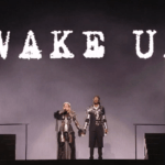 "Madonna and Quavo stand under the words ""Wake Up"" at the end of the Eurovision performance of their song ""Future."" (Photo via Twitter/@madonnatribe)"