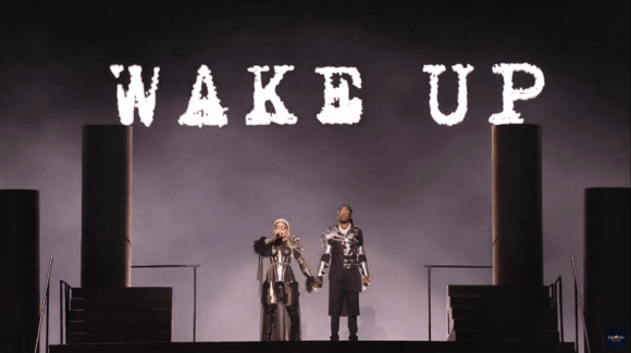 """Madonna and Quavo stand under the words """"Wake Up"""" at the end of the Eurovision performance of their song """"Future."""" (Photo via Twitter/@madonnatribe)"""
