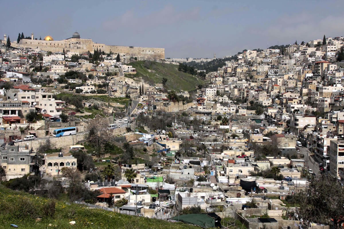General overview of the East Jerusalem neighborhood of Silwan, with the Jerusalem's Old City and the Dome of the Rock in the background, March 2, 2010. (Photo: Mohamar Awad/APA Images)