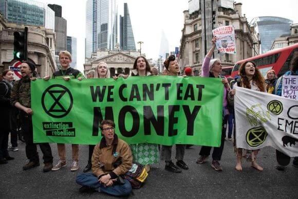 Activists with the organization Extinction Rebellion block the streets outside the Bank of England on April 25, 2019. (Photo: Mike Kemp via Getty Images)