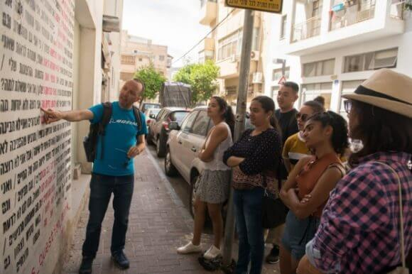 NYU Tel Aviv students explore graffiti during a walking tour for the Languages of Israel class. (Photo: NYU-Tel Aviv)