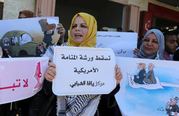 Palestinians protest against the Bahrain economic workshop, in Khan Younis in the southern of Gaza strip, on June 26, 2019. (Photo: Ashraf Amra)