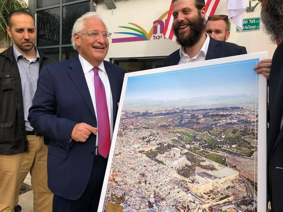U.S. Ambassador to Israel David Friedman being gifted with an altered image of the Haram al-Sharif/Temple Mount with the Al-Aqsa Mosque and Dome of the Rock replaced with a Jewish temple, May 2018. (Photo: Israel Cohen/Kikar HaShabbat)