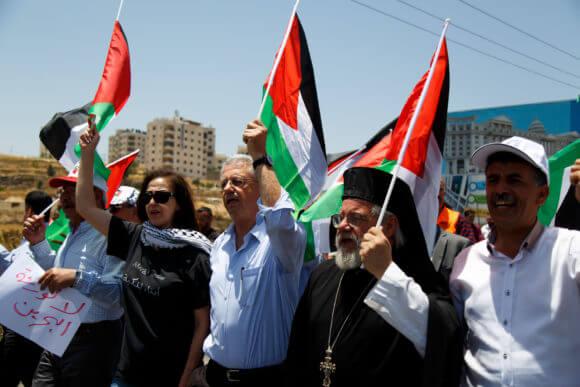 Mustafa Barghouti (center) protests the Trump administration's economic summit in Bahrain, outside of Ramallah, Wednesday June 26, 2019. (Photo: Miriam Deprez)
