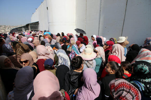 Palestinian women stand in lines at the Bethlehem 300 military checkpoint, May, 2019.