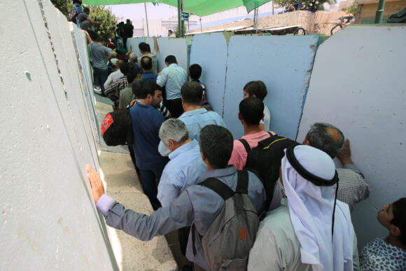 Palestinians stand in lines at the Bethlehem 300 military checkpoint, May, 2019.
