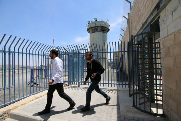 Palestinians are turned away from Qalandiya checkpoint after being forbidden from crossing over to Jerusalem to attend the Friday prayers of Ramadan.