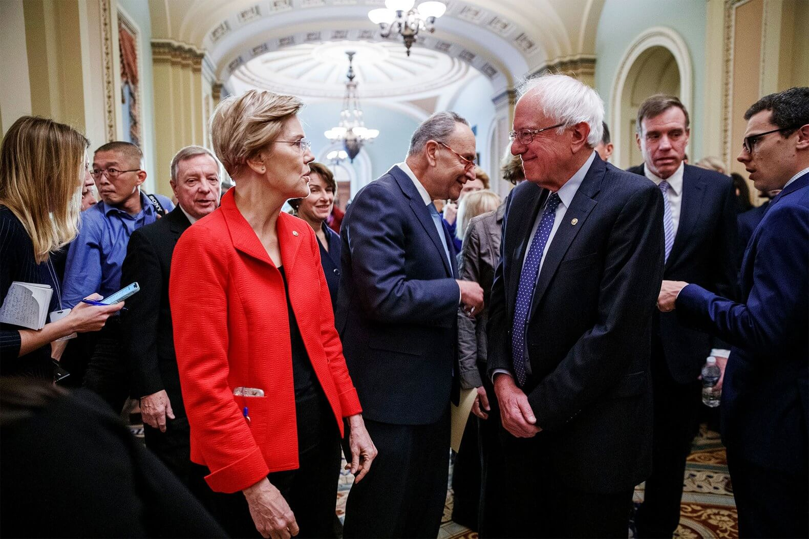 Elizabeth Warren and Bernie Sanders talk following a press conference at the U.S. Capitol. Nov 14, 2018 (Photo: SHAWN THEW/EPA)