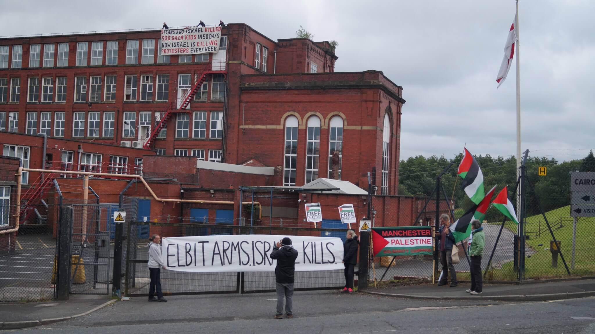Activists stage a protest on the roof of Elbit Ferranti in Oldham, UK. (Photo: Manchester Action Palestine)