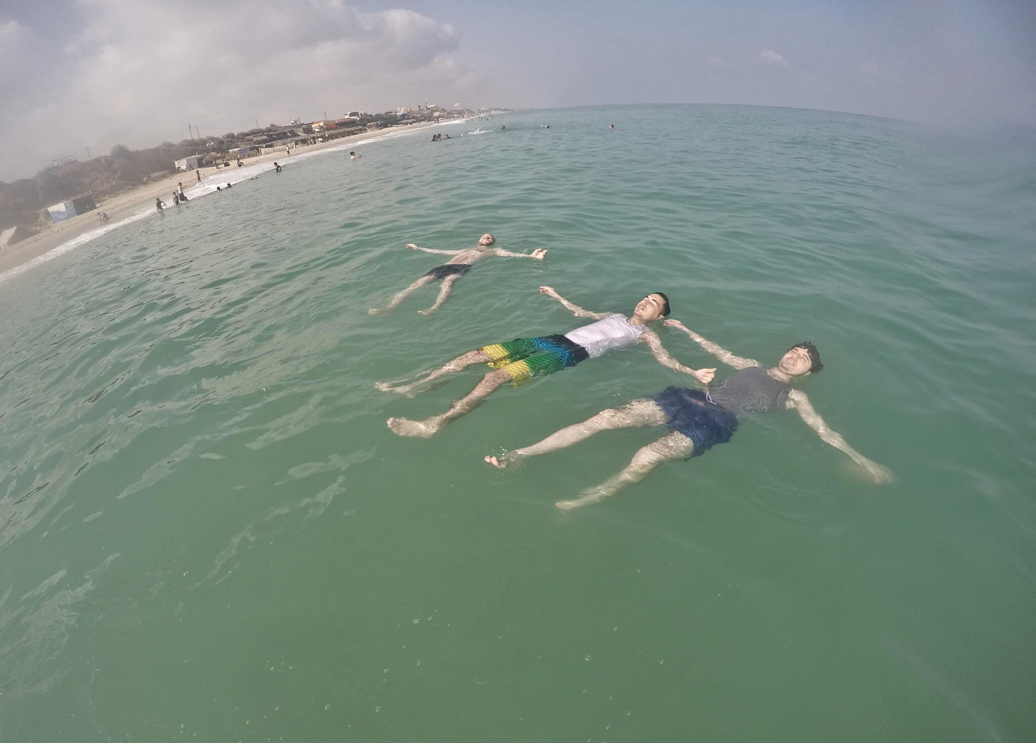 Palestinian beach goers enjoy swimming in Gaza, in the Mediterranean Sea.