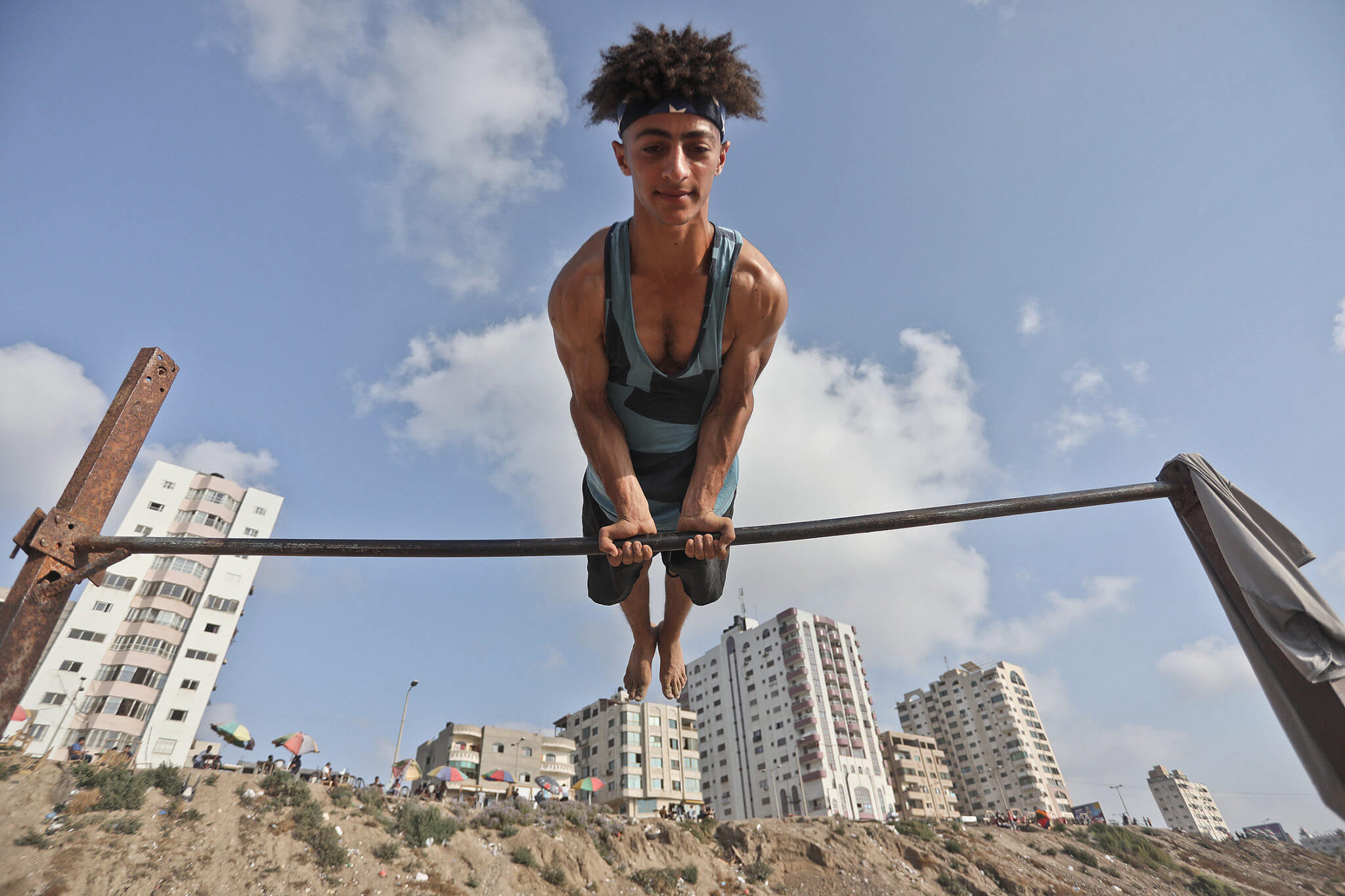 A man works out on the Gaza shore