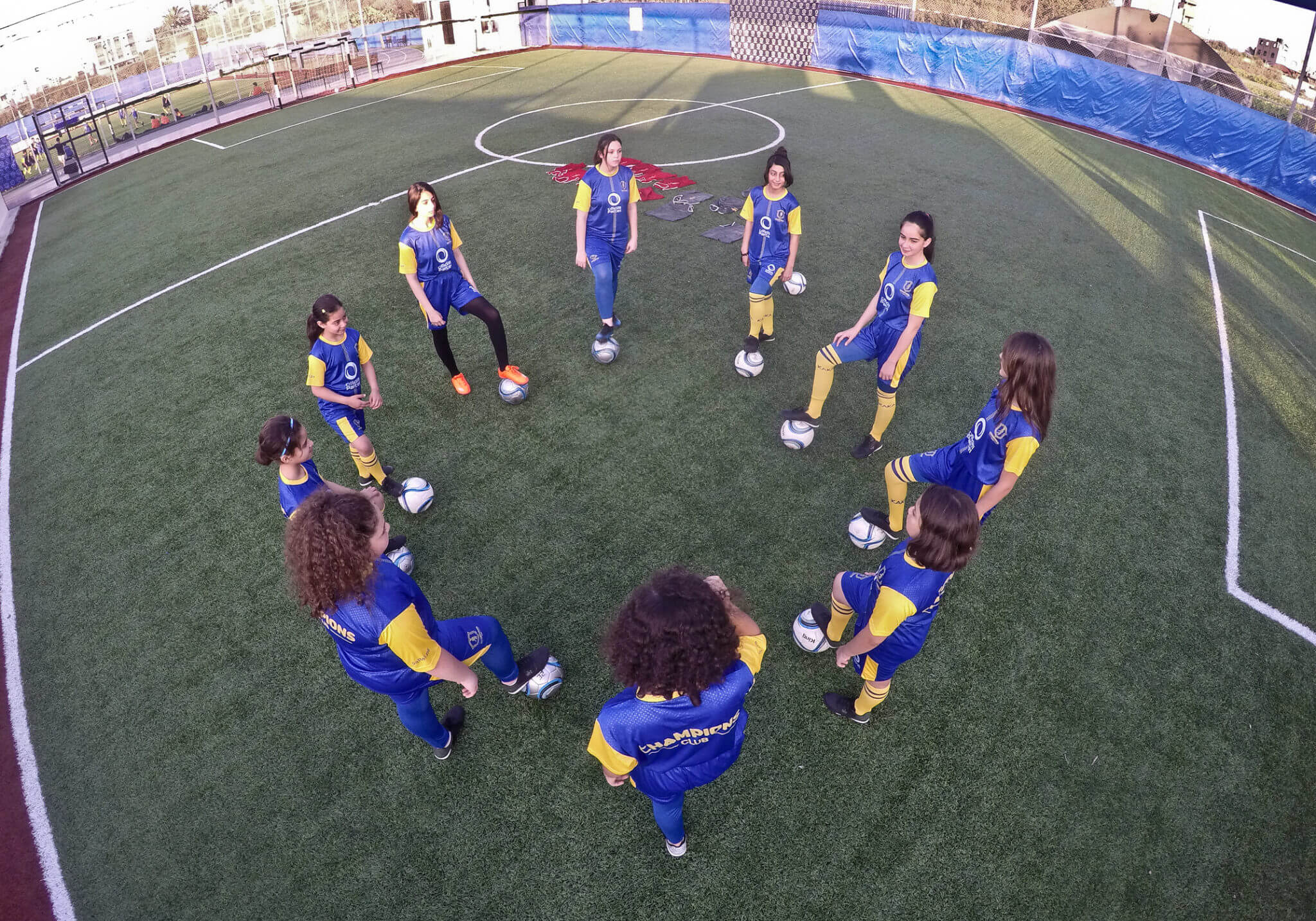 A youth soccer team holds its weekly practice on a playground in central Gaza City