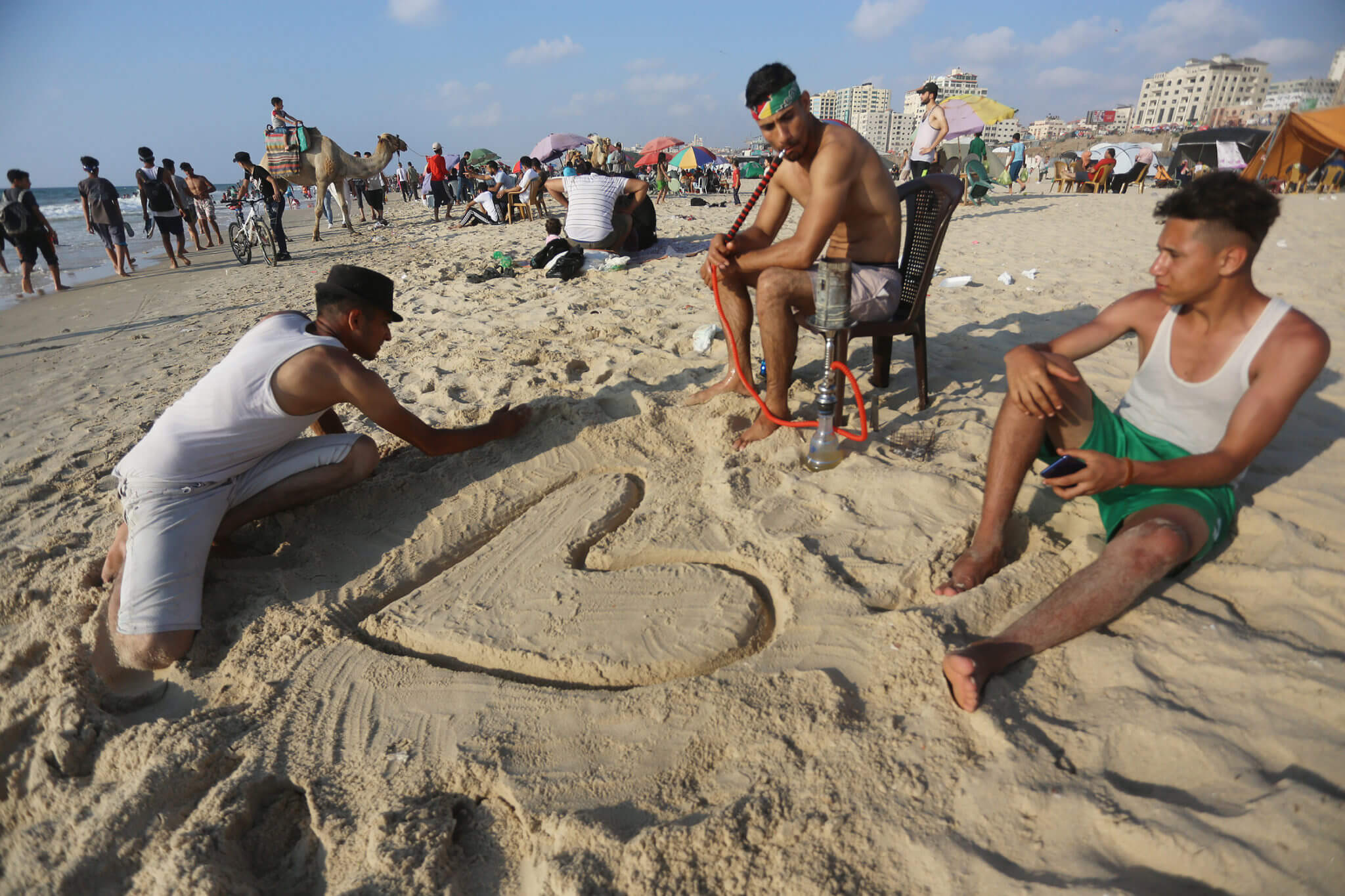 Beach goers enjoy their summer holiday after finishing the school year
