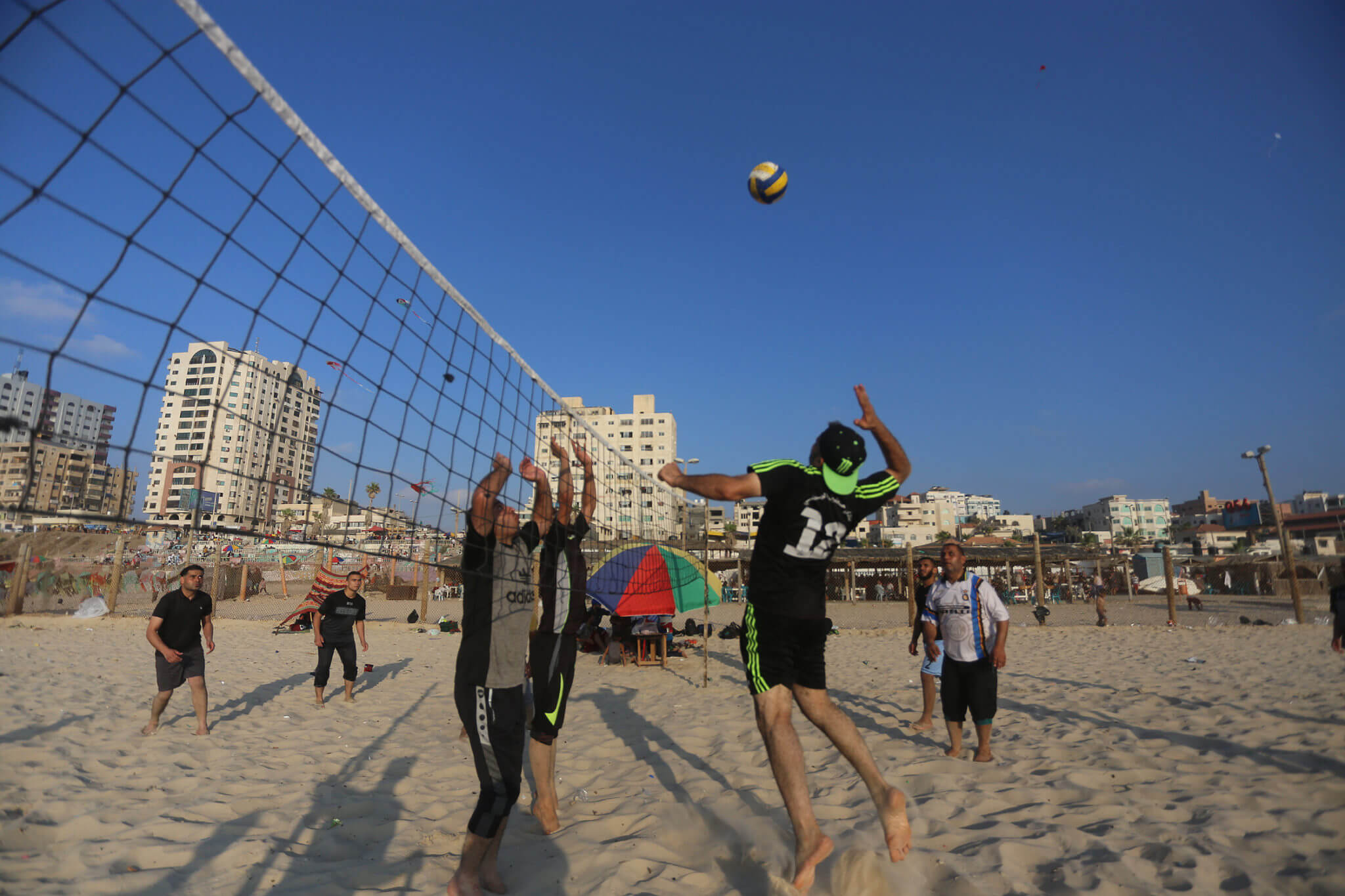 Volleyball players on the Gaza beach