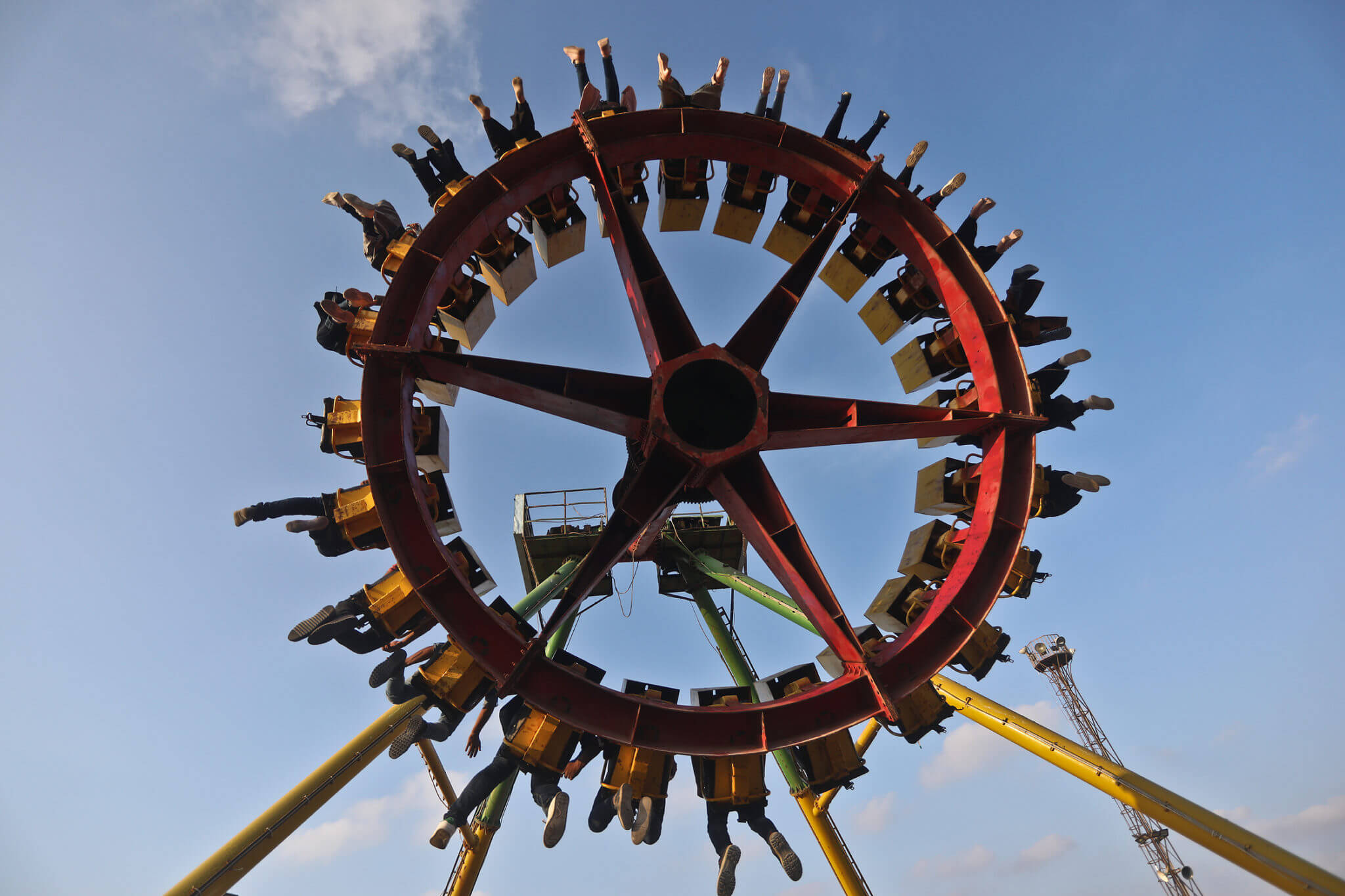 Visitors to Gaza's al-Nour park enjoy the spin-and-swing ride.