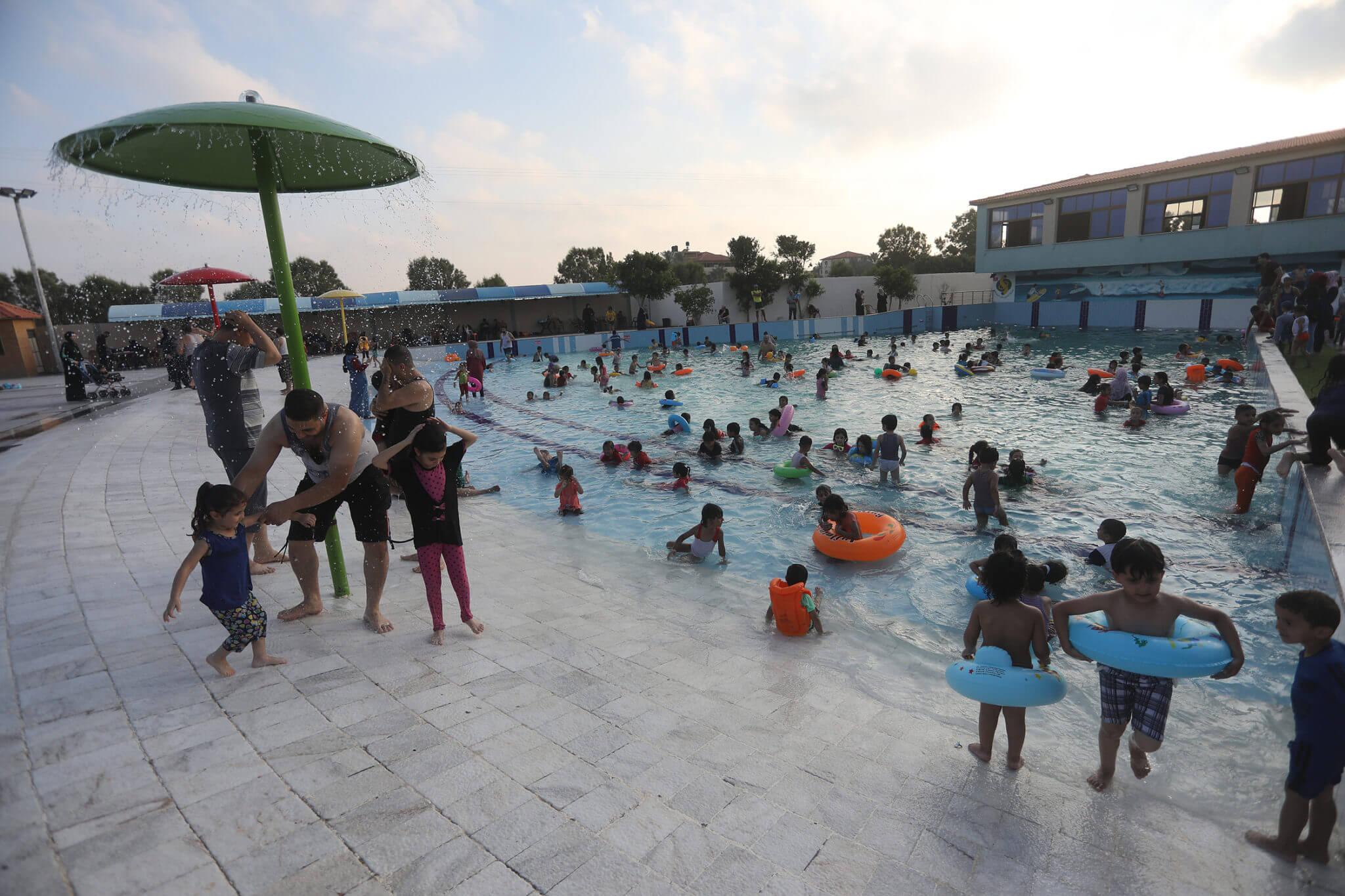 Families swim in an artificial wave pool