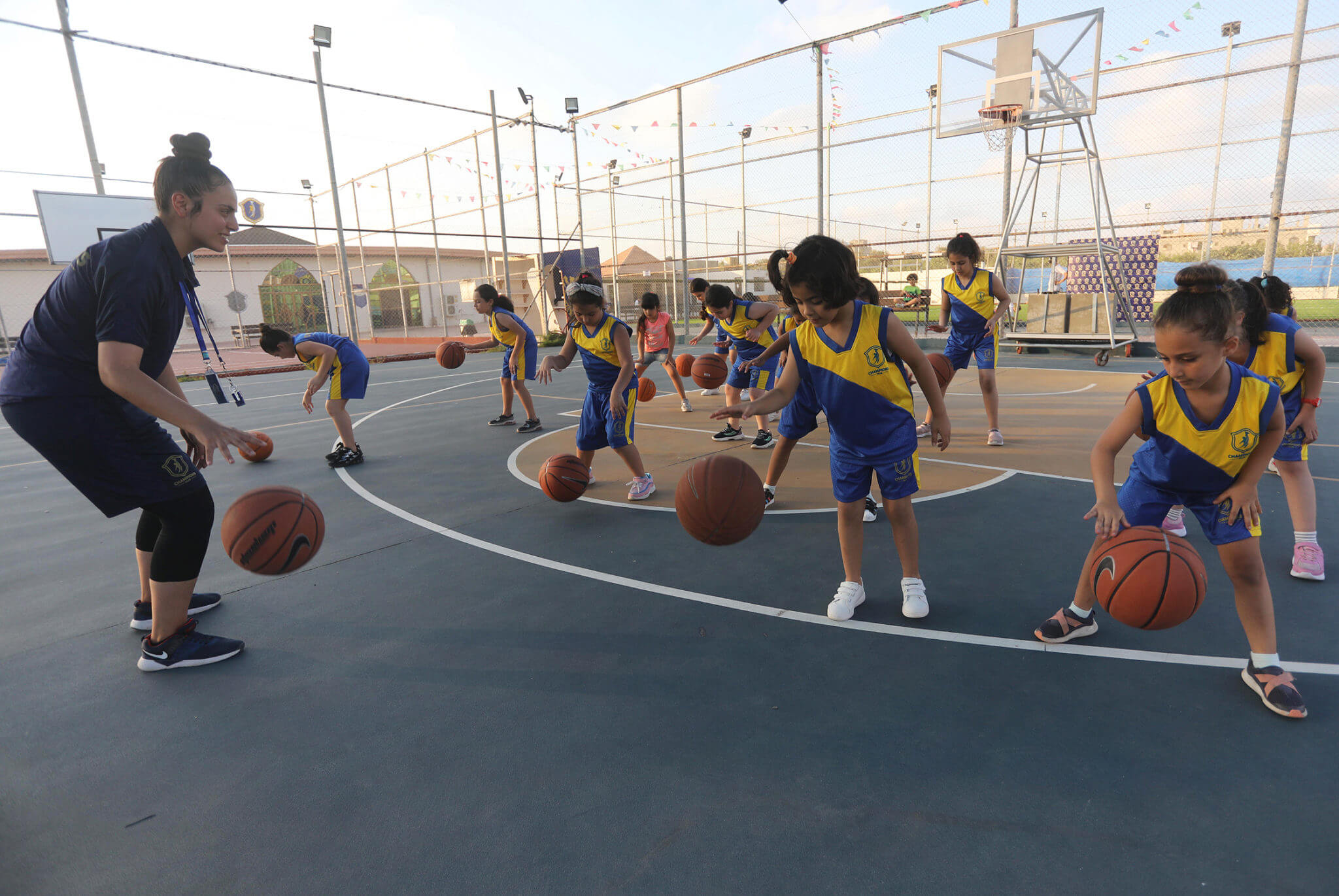 A young basketball team trains at the Champion Club in western Gaza