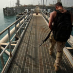 U.S. Navy soldier on Iraq's Mina al Bakr Oil Terminal in 2003. (Photo by PH1 Shane T. McCoy/US Navy)