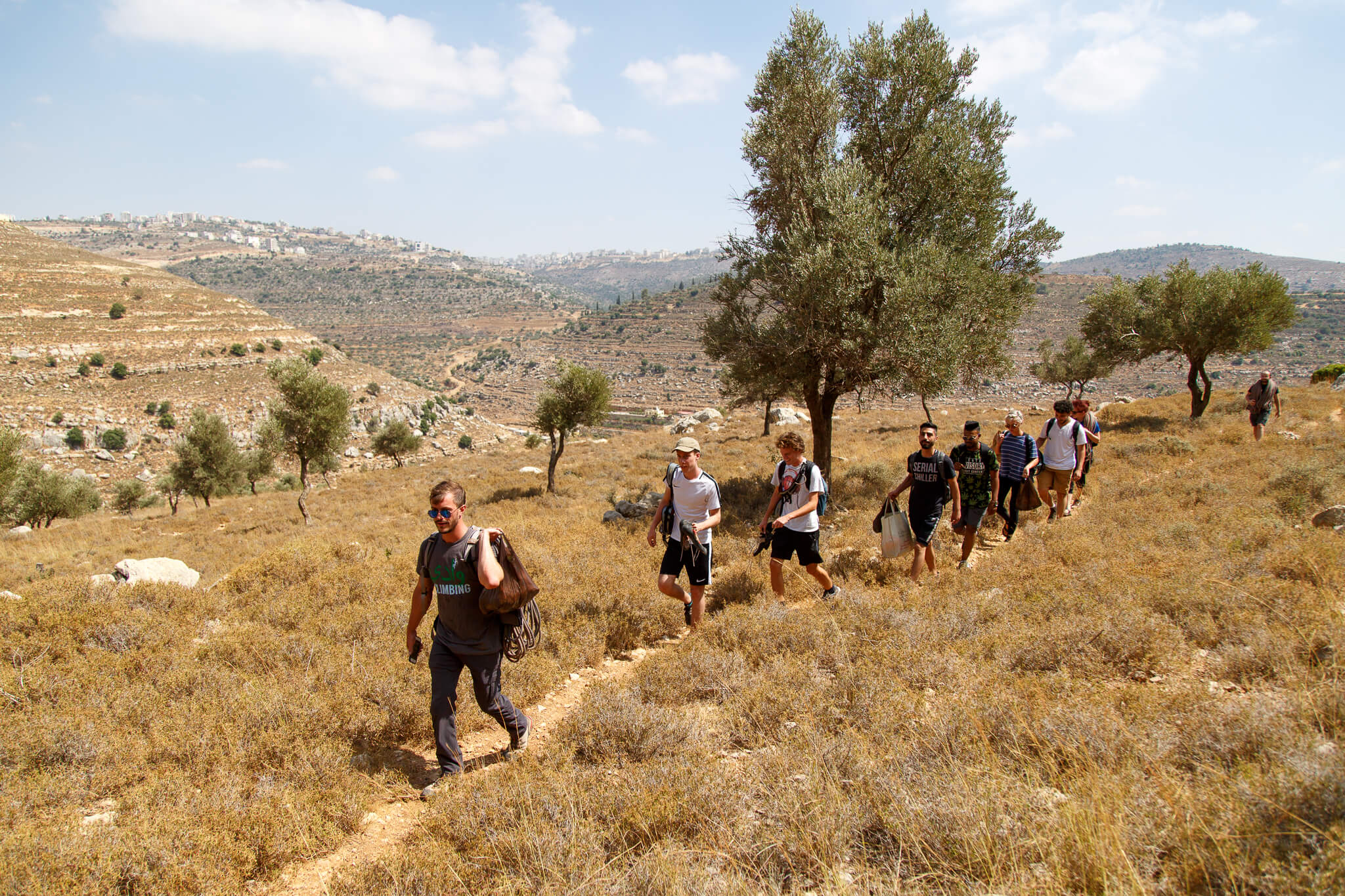 Manager of Wadi Climbing, Tyler Myers leads the group up through the valley of Ein Qiniya to the rock climbing spot. (Photo: Miriam Deprez)