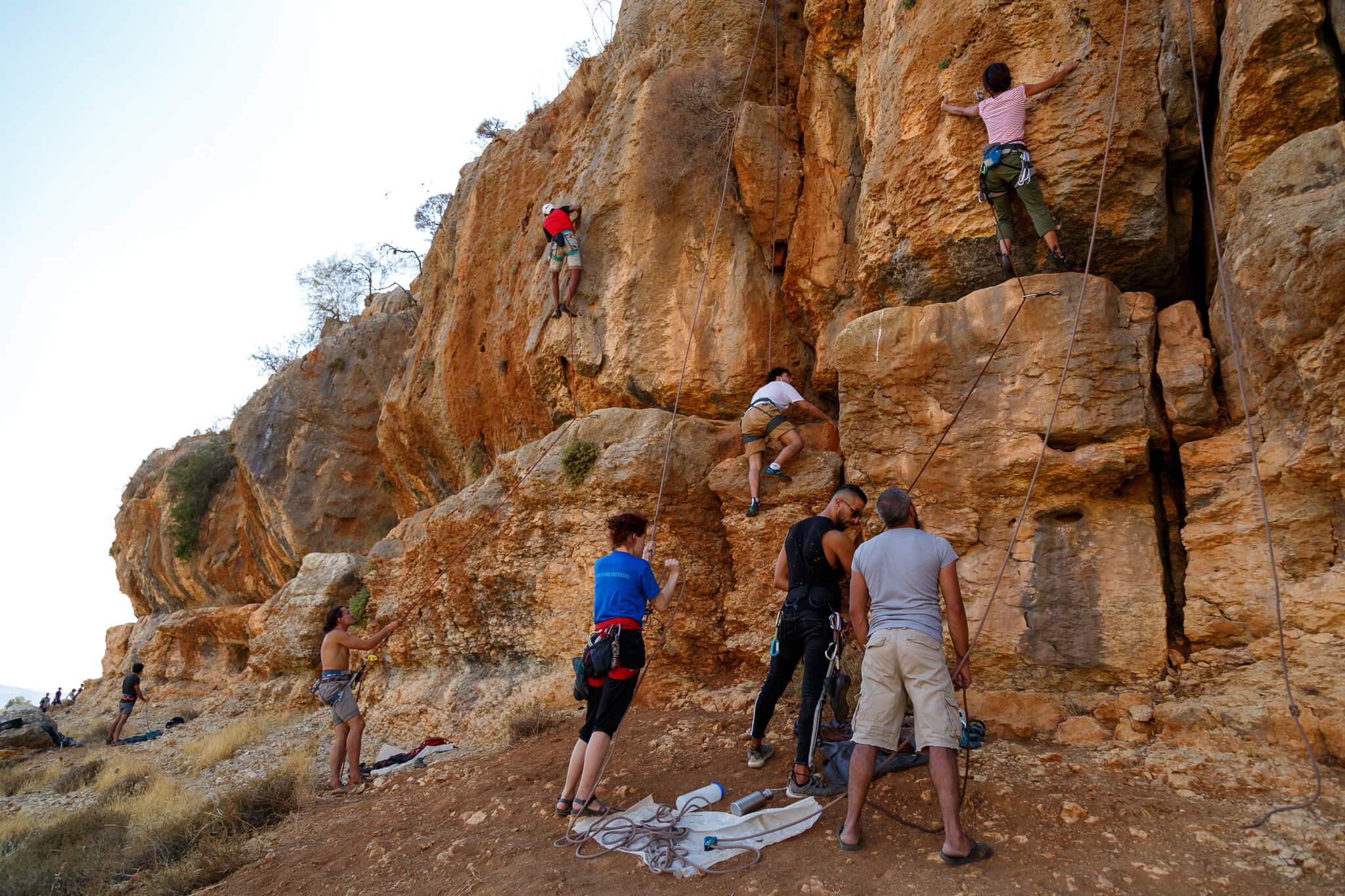 Rock climbers with Wadi Climbing in the scale a limestone bluff in the West Bank city of Ein Qiniya. Routes range from beginner climbs to advanced. (Photo: Miriam Deprez)