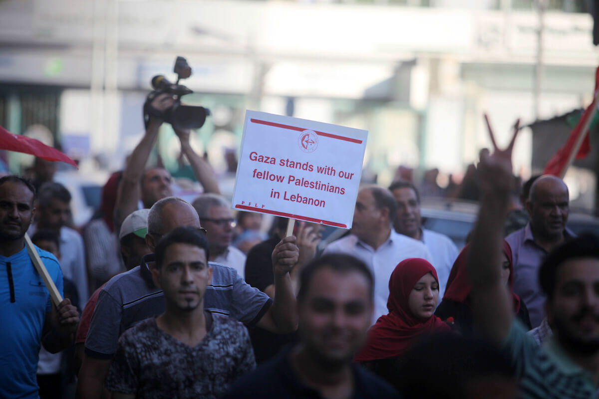 Protesters take part in a demonstration in solidarity with Palestinian refugees in Lebanon, and in solidarity with Palestinain prisoners in Israeli jails, in Gaza city on August 07, 2019. Protests over labour conditions for Palestinians in Lebanon are spreading from refugee camps into city streets as frustration grows over curbs on their civil rights. (Photo: Mahmoud Ajjour/APA Images)