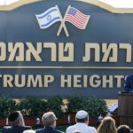 "Prime Minister Benjamin Netanyahu gives a speech before the newly-unveiled sign for the new settlement of ""Ramat Trump"", or ""Trump Heights"" in the Golan Heights on June 16, 2019."