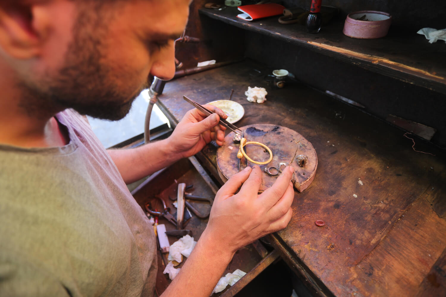 A goldsmith forms jewelry in a shop in Gaza City. (Photo: Mohammed Asad)