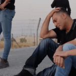 "Ismail sits with one of his sons after being thrown out of their home. (Screenshot from Yuval Abraham's film ""A Dark Night in Wadi al-Hummus"")"
