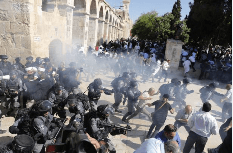 Israeli police fire sound grenades inside the Al-Aqsa Mosque compound in the Old City of Jerusalem on August 11, 2019, as clashes broke out during the overlapping Jewish and Muslim holidays of Eid al-Adha and the Tisha B'av holdiay. (Photo: Ahmad Gharbali/AFP/Getty Images)