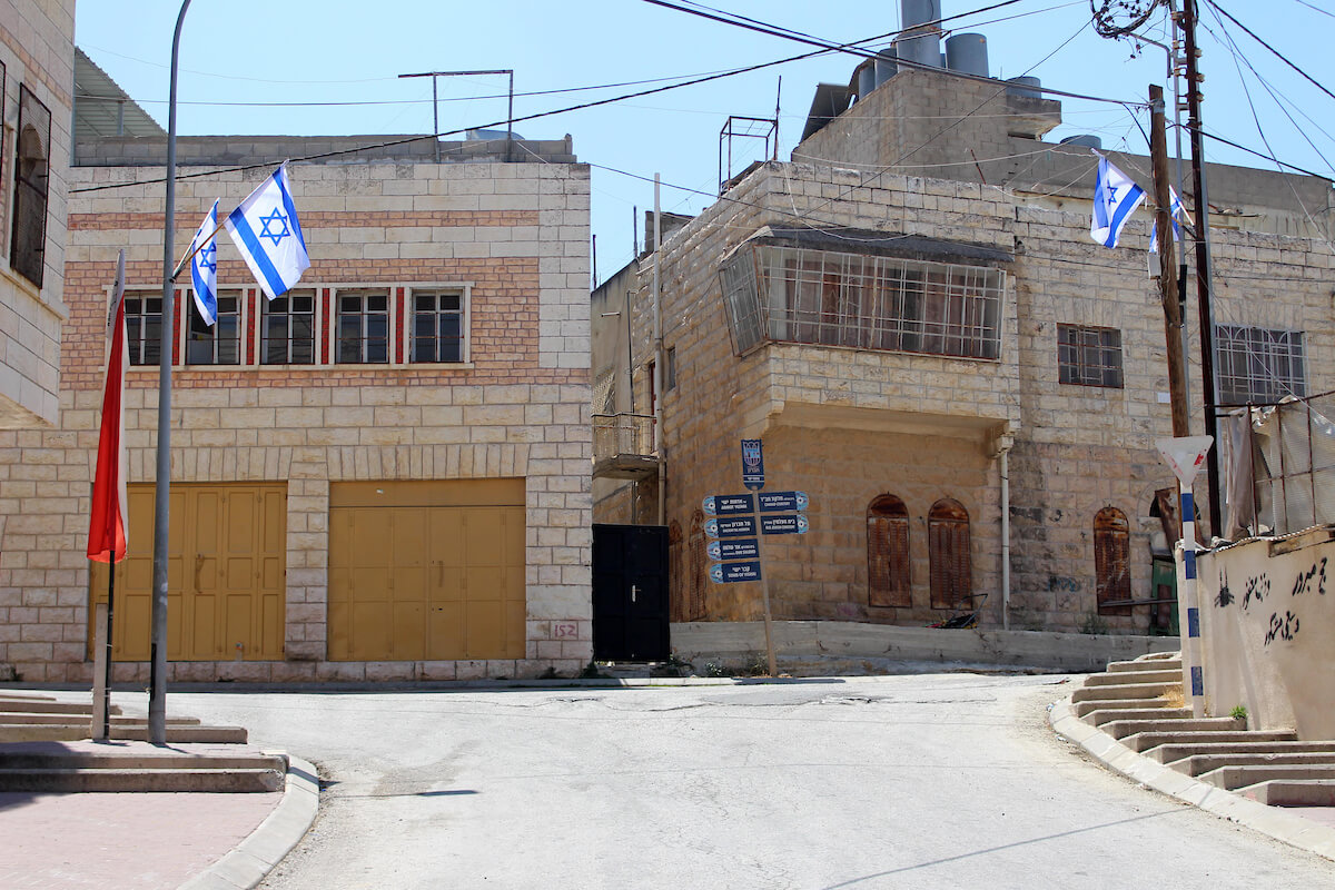 The Israeli flags are seen near the Ibrahimi mosque in the old city of the West Bank city of Hebron, on September 3, 2019. (Photo: Mosab Shawer/APA Images)