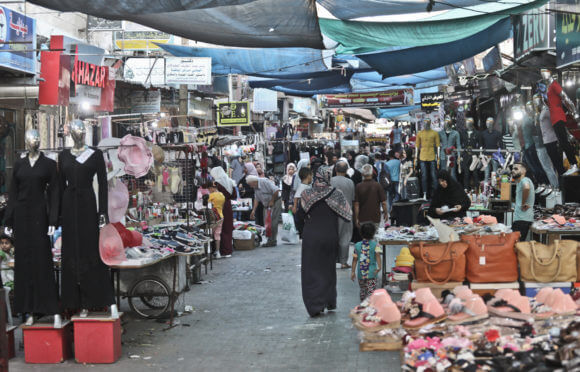 A popular outdoor market in al-Nuseirat refugee camp in the Gaza Strip. (Photo: Mohammed Assad)