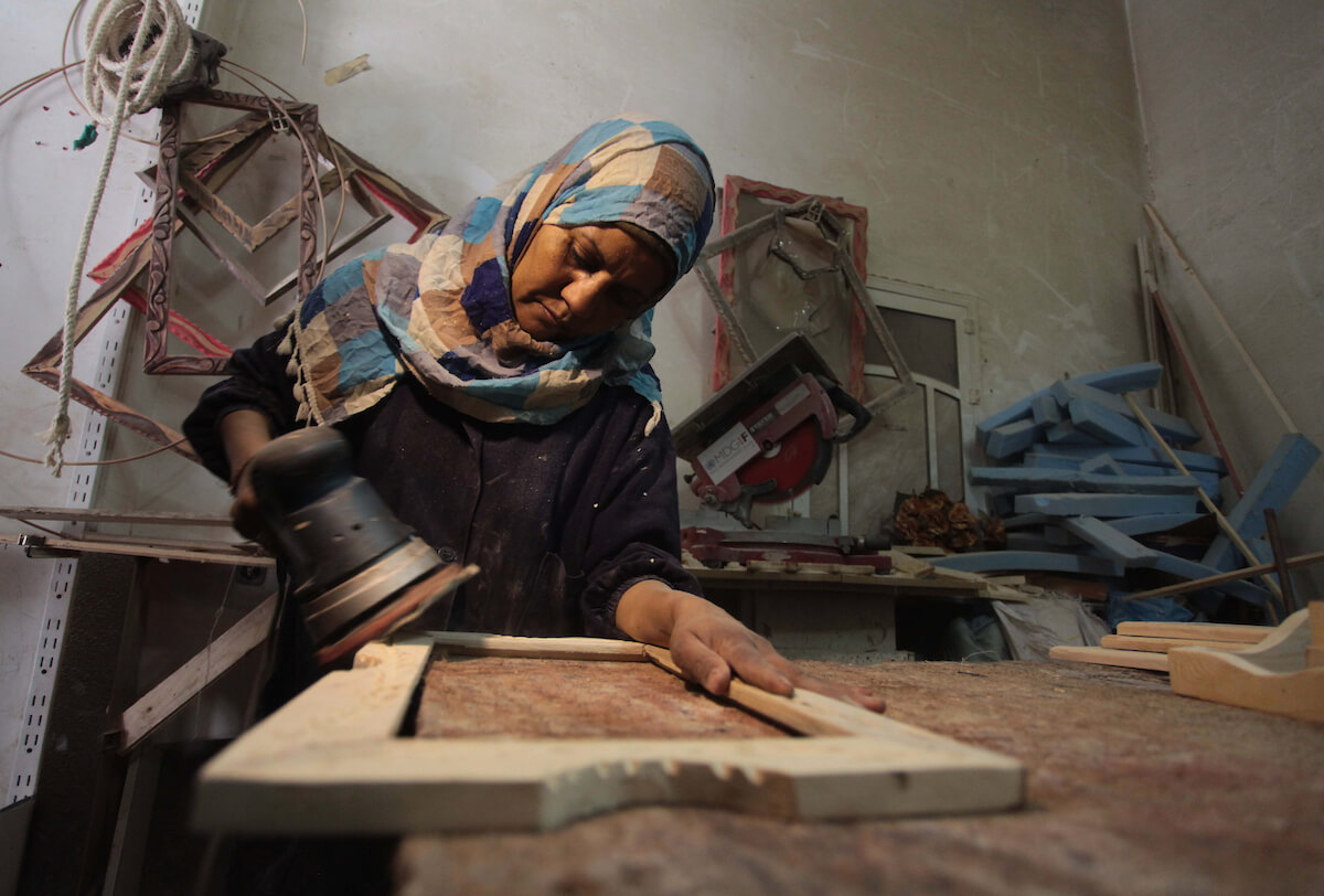 Amal Abu-Rqayiq, 40, works at her small carpentry workshop in the Nuseirat refugee camp in the Gaza Strip on March 8, 2014. Amal is a single mother working in a male dominated profession. (Photo: Ashraf Amra/APA Images)