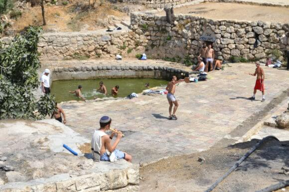 On the edge of downtown Jerusalem, among the ruins of the Palestinian village Lifta, Israeli Jews enjoy natural spring waters that once were central to the life of the village