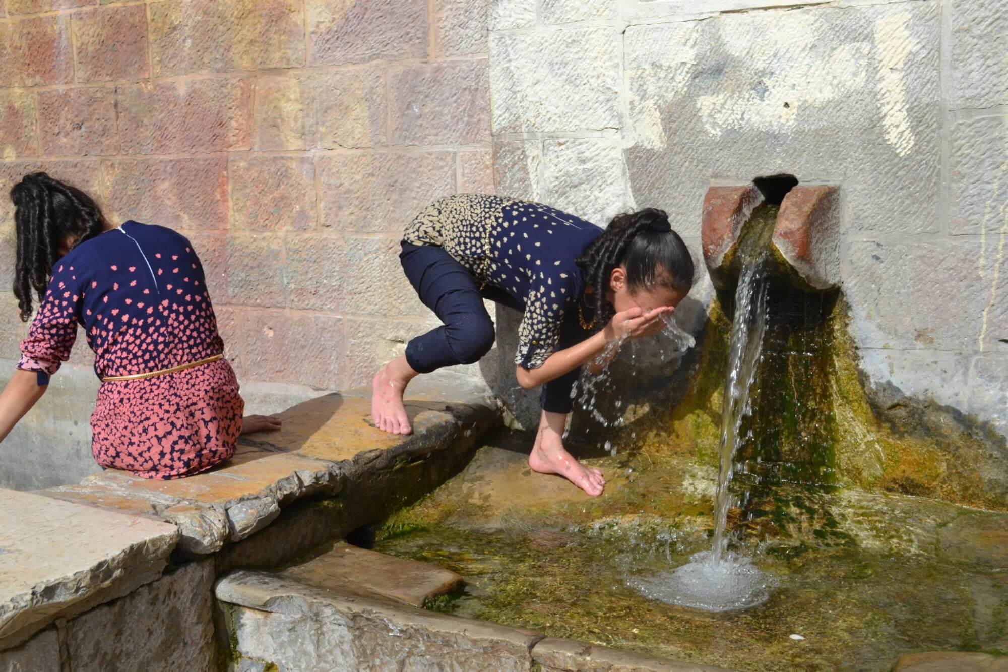 Palestinian girl freshens up at natural spring, Battir village, Bethlehem district, Palestine (Photo: David Kattenburg)