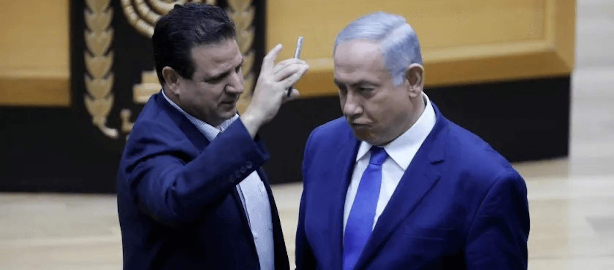 Ayman Odeh of the Joint List mocks Benjamin Netanyahu on the Knesset floor last week over Netanyahu's threat to put cameras in polling places, to intimidate Palestinian voters.
