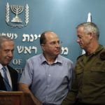 Benjamin Netanyahu next to the former Defense Minister Moshe Yaalon and then Chief of Staff General Benny Gantz (R) on 27 August 2014.