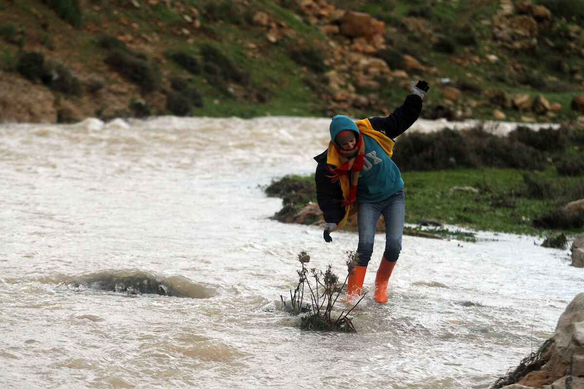 A Palestinian girl passes through flooding water in the village of Ein Qiniya near the West Bank city of Ramallah, Jan. 9, 2013. Extreme weather, including torrential rains and heavy winds, killed four people in Israel and the Palestinian territories on January 8, 2013, as widespread flooding swept the Middle East. (Photo: Issam Rimawi/APA Images)