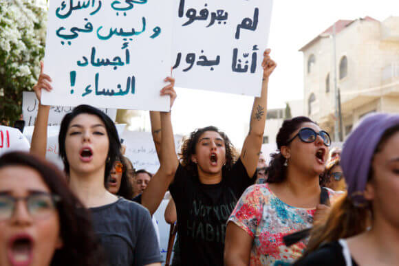 Founder of feminist clothing store Baby Fist, Palestinian-American Yasmeen Mjalli (center), 23, marches with a group of 100 protesters in Bethlehem. (Photo: Miriam Deprez)