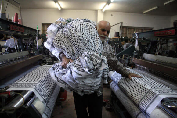A Palestinian man works at the Herbawi factory in the West Bank city of Hebron on October 14, 2010. (Photo: Najeh Hashlamoun/APA Images)