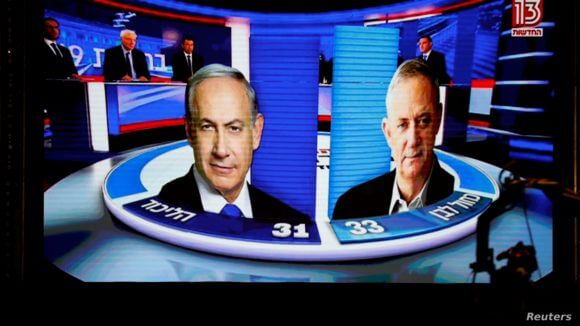 The results of the exit polls are shown on a screen at Benny Gantz's Blue and White party headquarters, following Israel's parliamentary election, in Tel Aviv, Israel, Sept. 17, 2019. (Photo: Reuters)