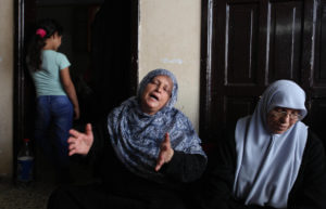 Relatives of Othman Helles who was shot dead by Israeli troops during clashes at Gaza-Israel fence mourn during his funeral in Gaza city on July 14, 2018. (Photo: Mahmoud Ajour/APA Images)